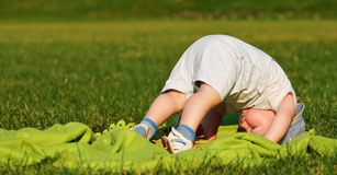Child doing a somersault